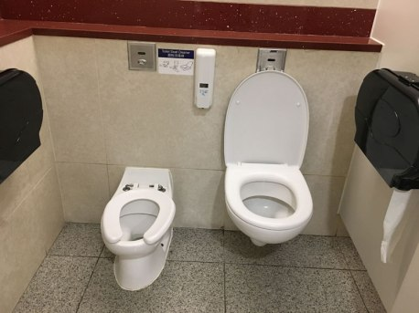 mommy and me toilet stall at airport