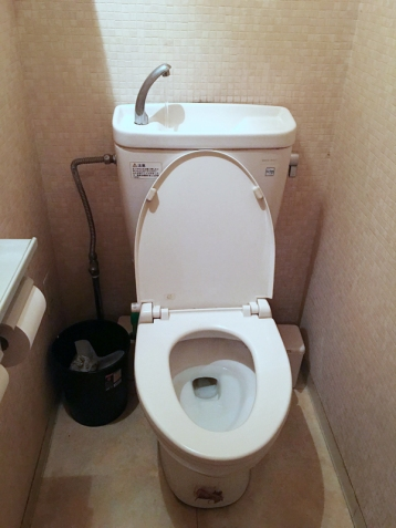toilet with a sink that turns on when you flush and fills the tank