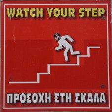 hacked sign, Santorini, Greece