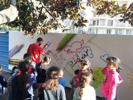 children tell street artist what to paint