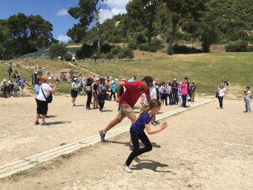 starting the race in ancient Olympian stadium