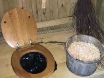 eco/dry toilet in tree house (plastic bag with sawdust on the side)