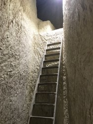 ladder leading to tunnels in rock quarry