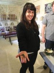 Carolina holding silk worm at la Magnanerie, Loire Valley