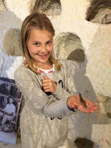 Natalie holding a silk worm at la Magnanerie, Loire Valley