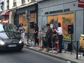 playing music on the sidewalk