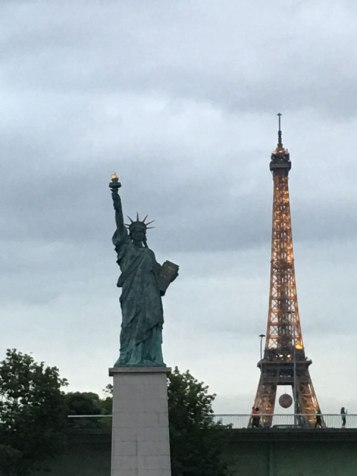 Eiffel Tower and a mini Statue of Liberty