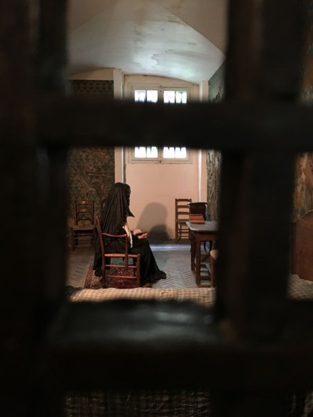 looking into Marie Antoinette's recreated cell in the Conciergerie, Paris