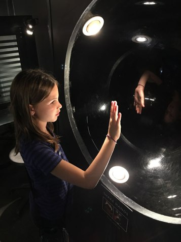 Lucy reaches out to her hand's reflection, Camera Obscura Museum